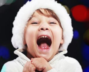 Image of a child excited about Christmas
